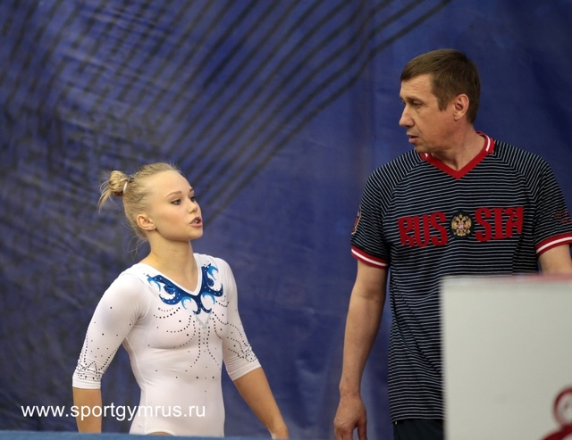 With her coach Sergei Denisovich