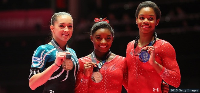 GLASGOW, SCOTLAND - OCTOBER 29:  (l-r) Larisa Andreea Iordache of Romania wins bronze, Simone Biles of USA wins gold and Gabrielle Douglas of USA wins silver medal in the All-Around Final on day seven of the 2015 World Artistic Gymnastics Championships at The SSE Hydro on October 29, 2015 in Glasgow, Scotland.  (Photo by Alex Livesey/Getty Images)