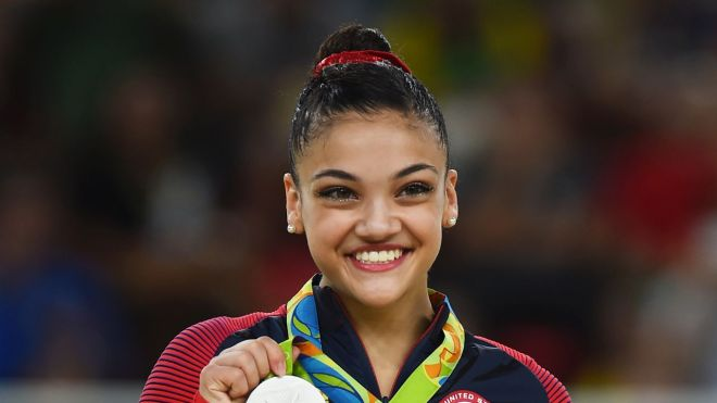 RIO DE JANEIRO, BRAZIL - AUGUST 15: Silver medalist Lauren Hernandez of the United States celeberates on the podium at the medal ceremony for the Balance Beam on day 10 of the Rio 2016 Olympic Games at Rio Olympic Arena on August 15, 2016 in Rio de Janeiro, Brazil.  (Photo by Laurence Griffiths/Getty Images)