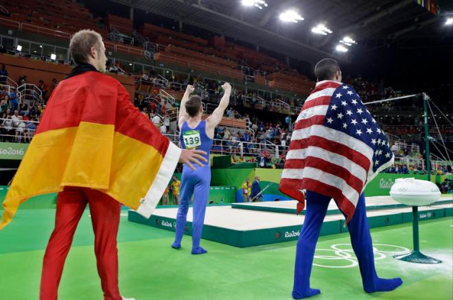 From left, gold medallist Germany's Fabian Hambuechen, bronze medallist Britain's Nile Wilson, and silver medallist United States' Danell Leyva celebrate during the medal ceremony for horizontal bar during the artistic gymnastics men's apparatus final at the 2016 Summer Olympics in Rio de Janeiro, Brazil, Tuesday, Aug. 16, 2016. (AP Photo/Rebecca Blackwell)