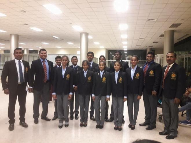 Sri Lankan men's and women's teams en route to Namibia